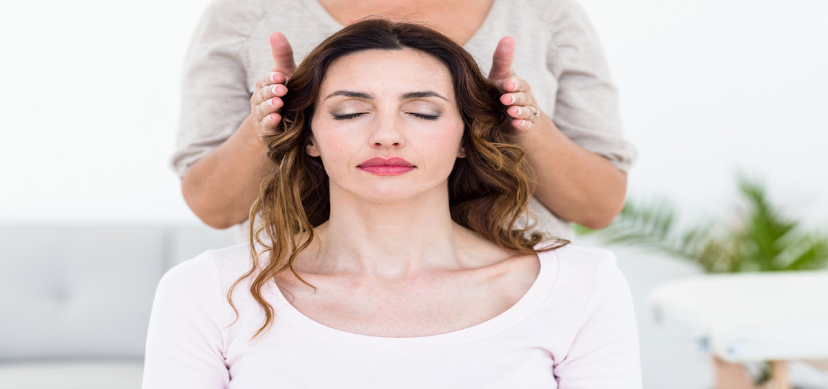 Life in Harmony WA bigstock-Calm-woman-receiving-reiki-tre-89050631-2-copy Reiki Master Training